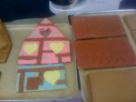 Now you can start to decorate using your coloured sugar paste, use brown on the roof and score to give a tiled effect.