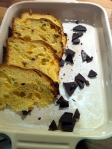 Sprinkle half of castor sugar over base of dish, and half of chocolate. Cover with slices of Panettone