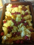 Crumble sponge over base, scatter over raspberries.