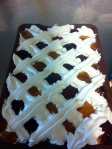 Whisk up meringue, pipe lattice pattern, fill gaps with alternate jam colours.