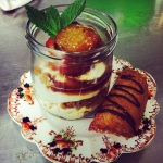White chocolate and gingersnap layered mousse with plums roasted in maple syrup.