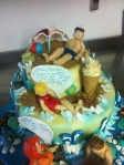 Summer cake display for restaurant , themed on british seaside postcards