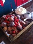 Coconut doughnuts, raspberry sauce