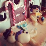 Snowmen have ipods (on gingerbread house)